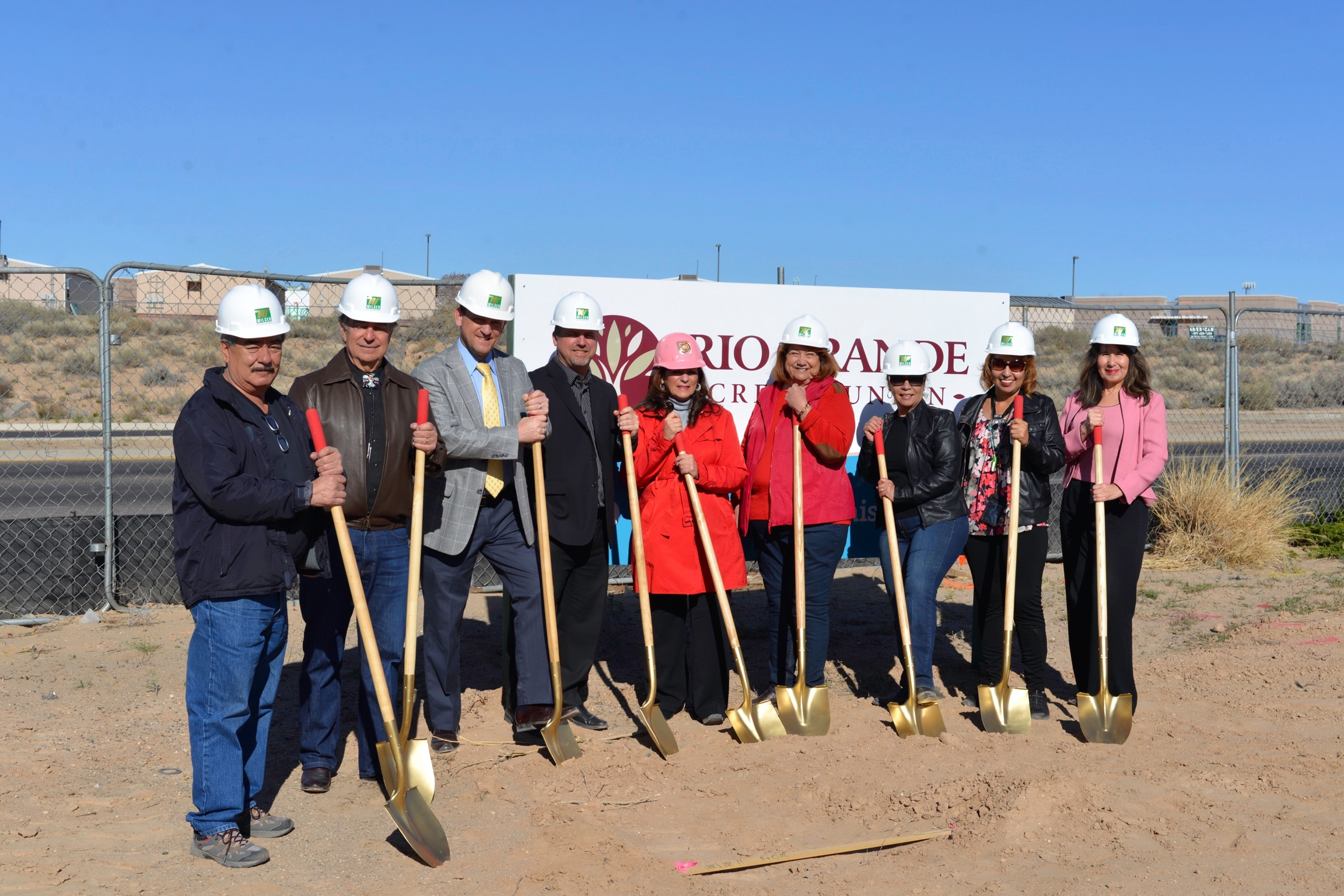 Photo of people ready to break ground for new branch